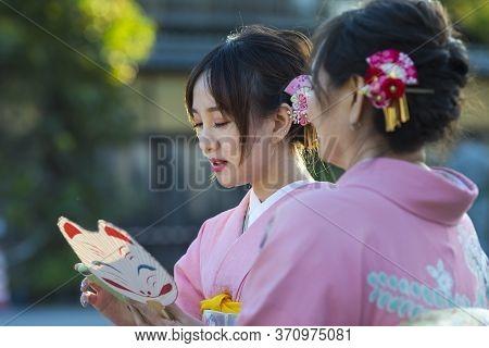 Kyoto, Japan - November, 8, 2019: Japanese Ladies Posing In Geisha Kimono At One Of The Kyoto Street