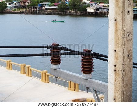 Electrical Insulators Connected High-voltage Cables On Power,electric Concrete Pole.