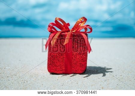 Gift Boxes On Sandy Beach. Hot Tours Or Holiday Vacation Concept With Summer Sea.