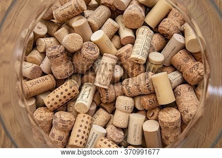 Odessa / Ukraine - 05 22 2020: Top View Of Round Glass Vase Neck With Used Wine Cork Stoppers Inside