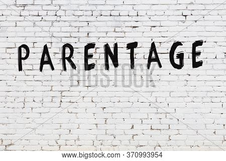 Word Parentage Written With Black Paint On White Brick Wall.
