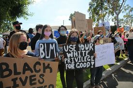 Lake Forest, CA / USA - June 6, 2020: Black Lives Matter protest taking place in solidarity with the USA protests against police brutality and the police murder of George Floyd. Editorial Use Only.