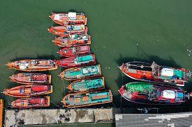 Fleet of fishing boats in port in Thailand.