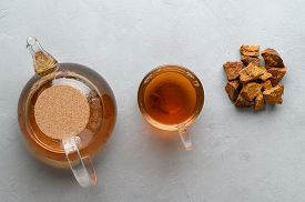Chaga Mushroom Drink In A Glass Cup And Teapot. Trendy Healthy Birch Mushrooms. Top View. Light Gray