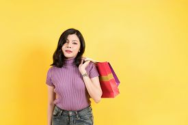 Fashion Shopping Girl Portrait On Yellow Background