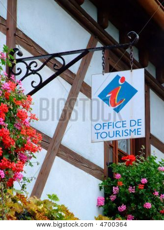 French Tourism Office Sign On Half-timbred Wall