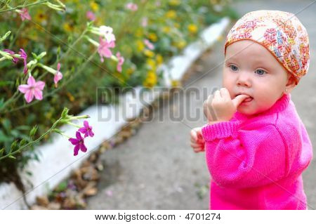 Pretty Little Girl With Flowers.