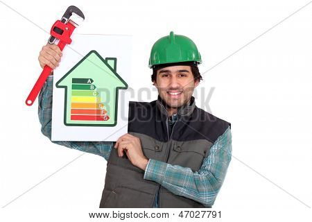 Tradesman holding a pipe wrench and an energy efficiency rating sign