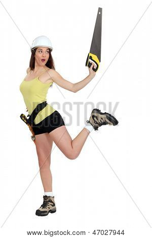 Woman doing pirouettes with a handsaw