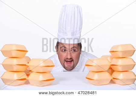 Chef surrounded by polystyrene foam takeaway boxes