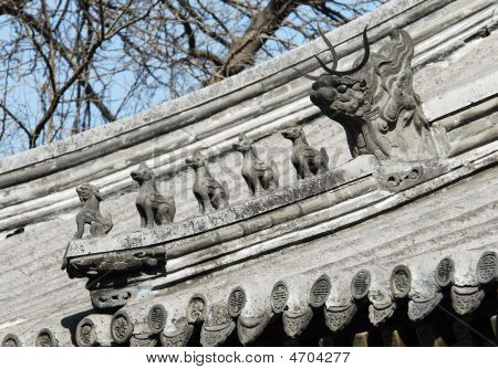 Chinese Decorative Figures On A Building Roof