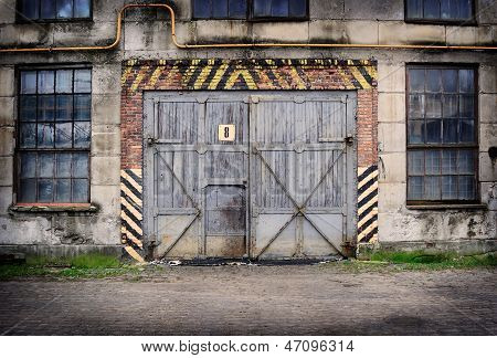 Abandoned Old Factory With Closed Door And Windows