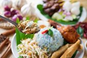 Nasi kerabu, famous Malaysian Malay rice dish. Traditional east coast blue rice. Popular in states such as Terengganu or Kelantan . Malaysia food, Asian cuisine. poster