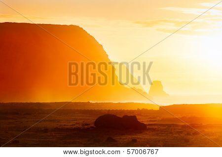 Fallen moai in golden morning haze in Easter Island poster