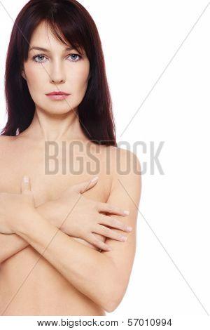 Beautiful slim mature woman over white background