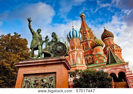 St Basils Cathedral with the monument for Minin and Pozharsky on Red Square in Moscow Russia poster