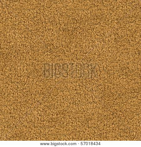 Seamless brown carpet closeup background.