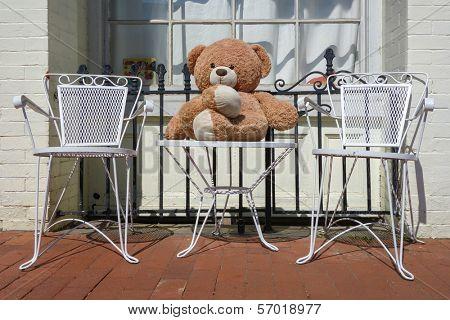 Toy bear on chair enjoys street commute
