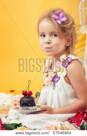 Portrait of slyly smiling girl posing with cake