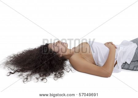 Beautiful young female fashion model lying on floor