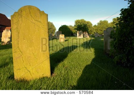 Gravestone At Sunset