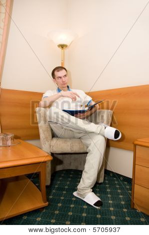 Portrait Of A Man Sitting In A Chair