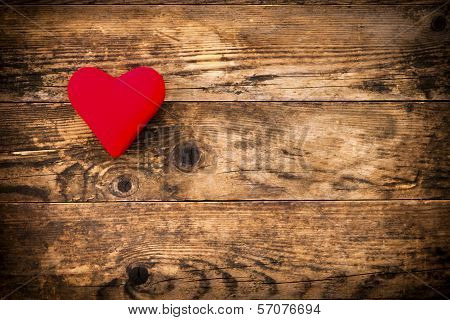 Red Heart Symbol On A Rustic Wooden Planks.