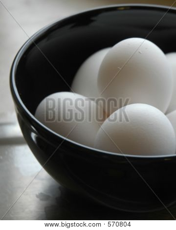 Eggs In A Black Bowl