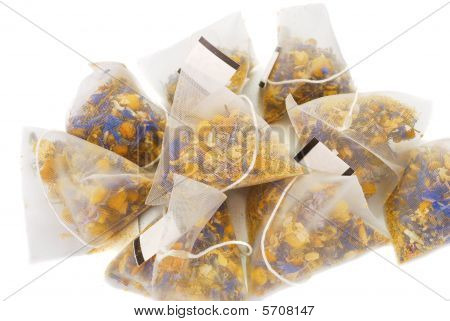 Bags with floers cardomille tea isolated on the white. poster