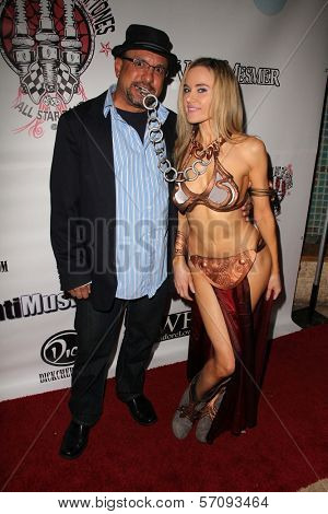 Kyle T. Heffner and Paula Labaredas at the Vera Mesmer Video Release Party, featuring Harry The Dog and Paula Labareas of ComicCosplay, Aqua Lounge, Beverly Hills, CA. 03-09-11