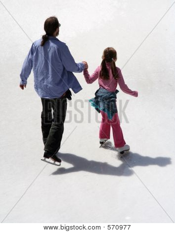 Father And Daughter Ice Skating