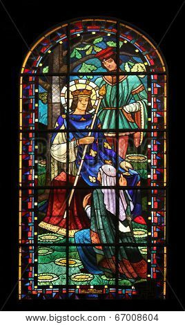 PARIS,FRANCE NOV 07:Saint Louis IX of France, Notre-Dame de Clignancourt church located in the 18th arrondissement of Paris. Completed in 1863. Windows are from the Art Deco period. On Nov 07 in Paris