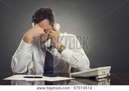 Overwhelmed  Businessman With Headache