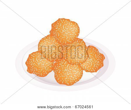 Fried Sweet Potato Balls With Sesame On Plate