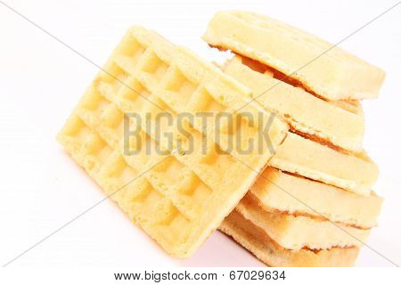 Pile of waffles on a white background ** Note: Soft Focus at 100%, best at smaller sizes