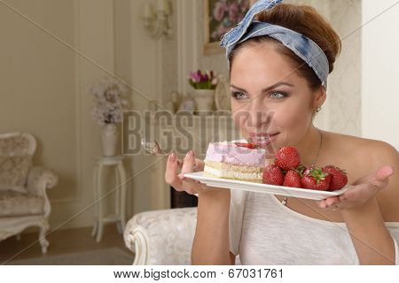 Young Woman And Strawberry Cake