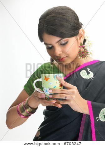 Teenage girl with coffee cup