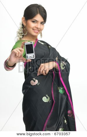 girl in sari showing the mobile