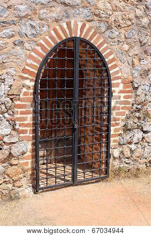 Wooden Gate Locked Steel Grate