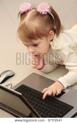 Child is studying computer