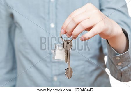 bunch of keys with fob in hand close up isolated on white background poster