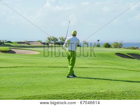 Golf club. Man playing golf