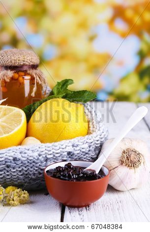 Folk remedies for colds on table on natural background