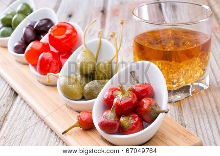 Savory Peppers And Olives Served With Whiskey