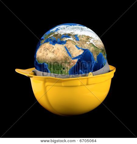 Yellow helmet with earth planet isolated on a black background poster