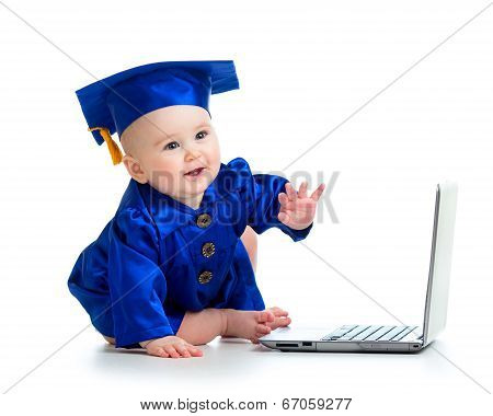 Happy Child In Academician Clothes  Using Laptop