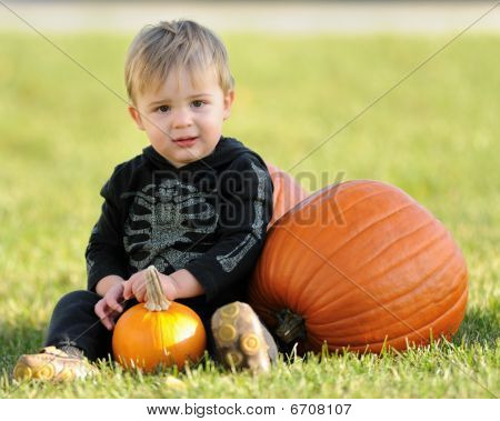 Young boy with pumpkins