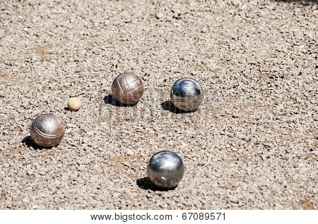 Petanque balls on gravel alley