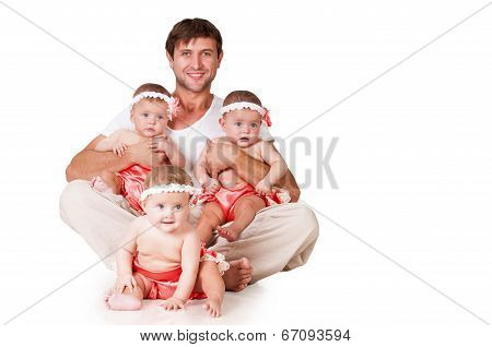 Happy Father And Little Daughter Triplets