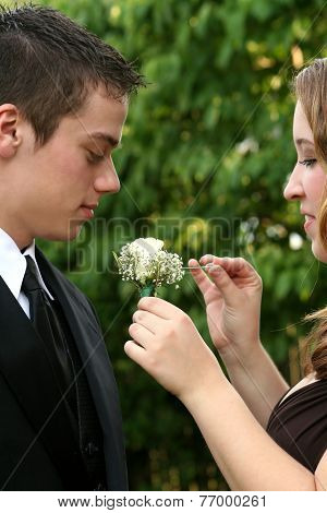 Prom Couple Preparing Boutonniere